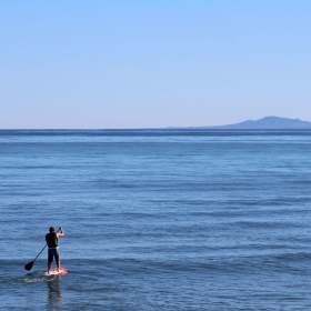 Stand-up Paddle Boarder at Campus Point. Credit: Katharine McLean